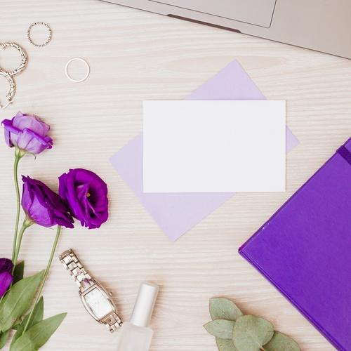 purple-eustoma-flowers-earrings-rings-diary-wristwatch-nail-polish-wooden-desk